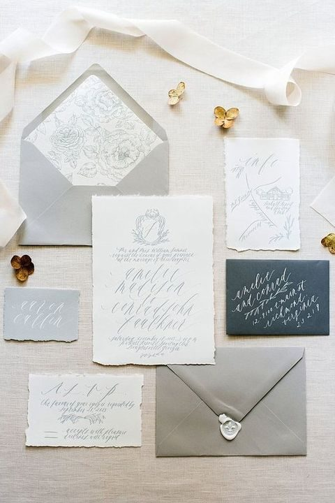 grey envelopes and neutral stationery with calligraphy