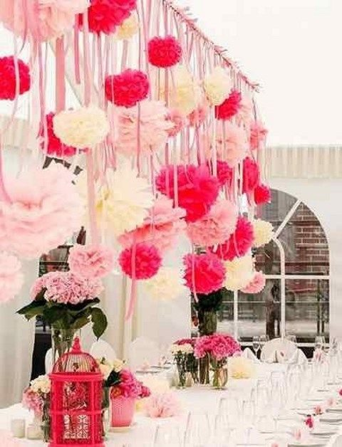 ivory and pink table decor, a lot of pompoms over the table
