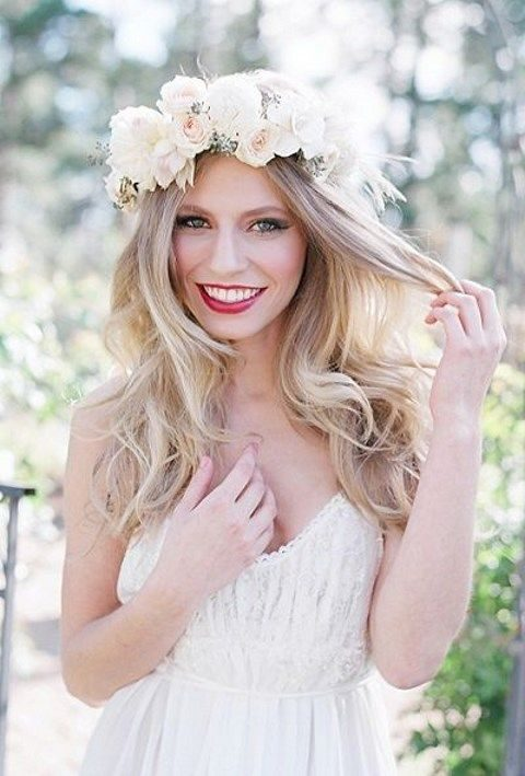 long wavy hair and a lush flower crown