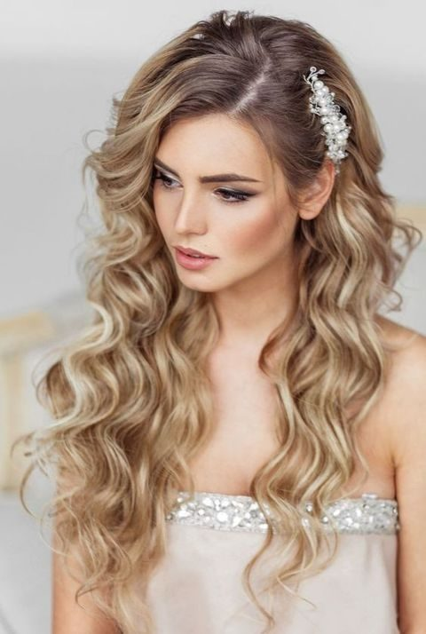 long wavy hairstyle and a beaded headpiece
