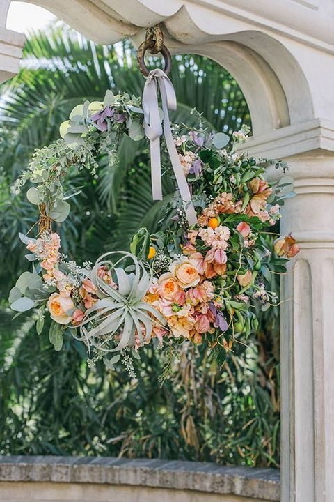 lush floral spring wreath with air plants