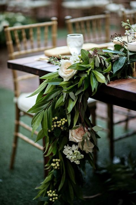 lush green leaves and roses table runner