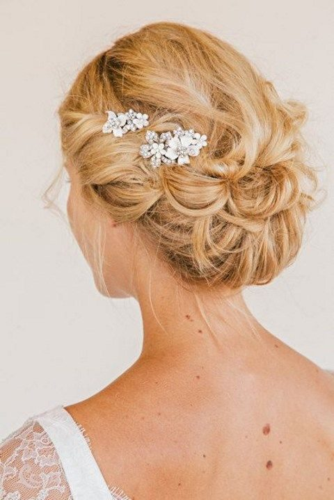 messy curly updo with a beaded headpiece
