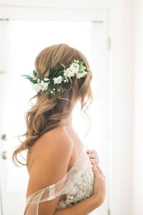 36 inspiring spring wedding hairstyle ideas happywedd messy wavy hair with white flowers mightylinksfo