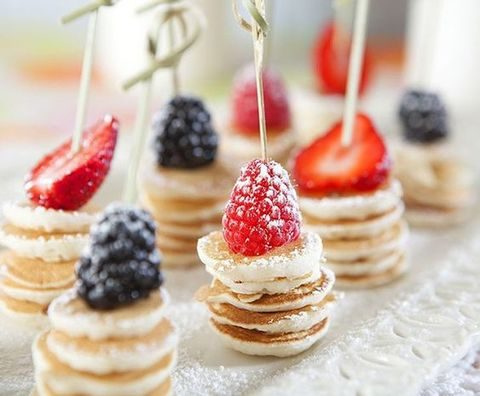 mini pancake stacks topped with berries