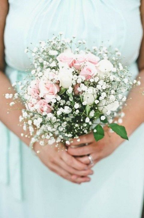 mint bridesmaid's dress and a pink and baby's breath bouquet