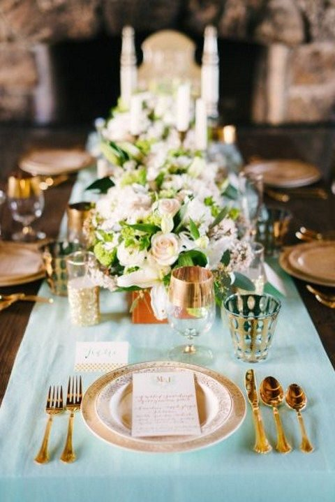 mint fabric table runner looks refined with gold tableware and ivory flowers