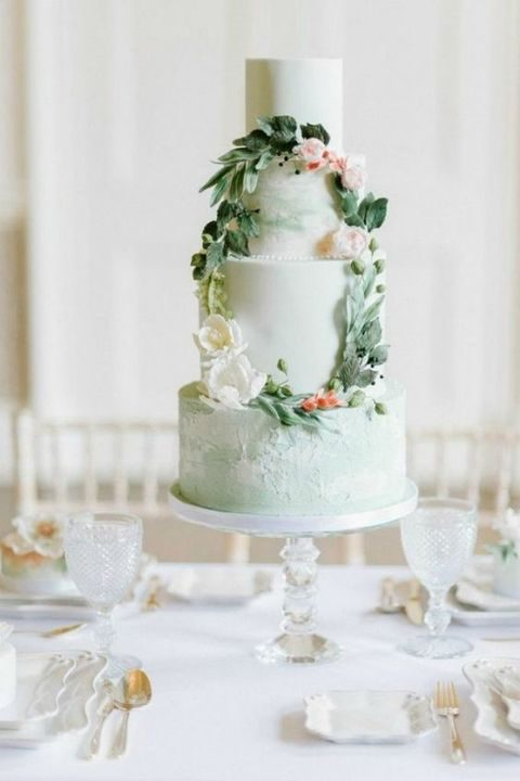 mint green cake decorated with a floral wreath