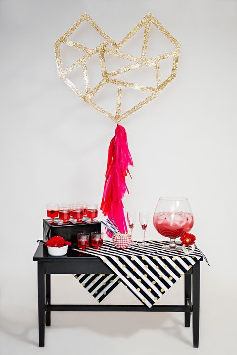 modern black, red and white drink table with gold polka dots