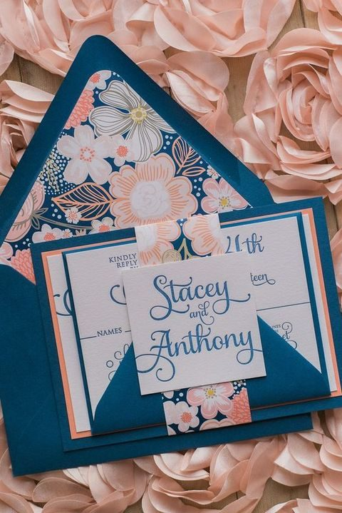 modern navy and coral wedding invitation with floral patterns