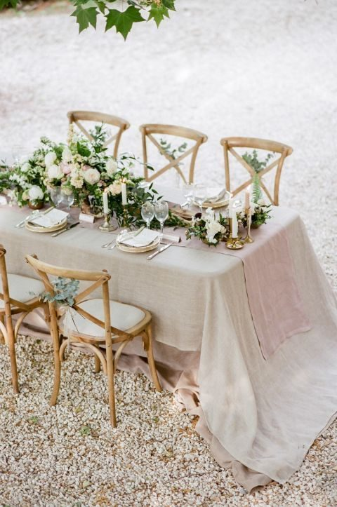 muted linens, peonies, candles and driftwood table decor