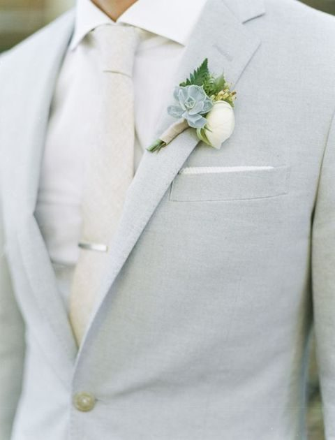 neutral groom's suit with a succulent boutonniere