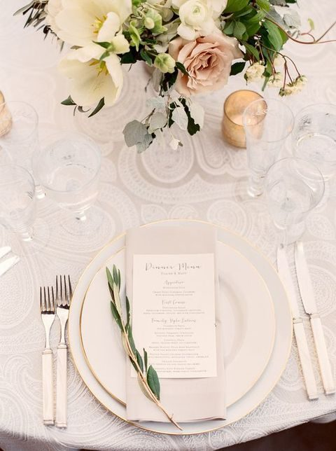 neutral lace tablecloth, pastel flowers and greenery