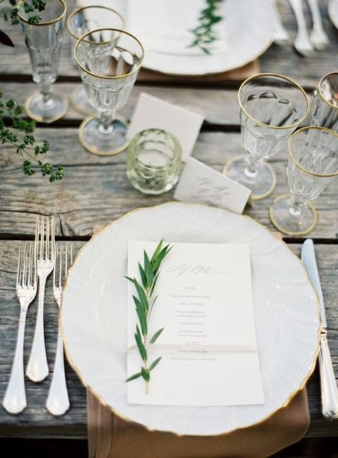neutral rustic table setting with greenery
