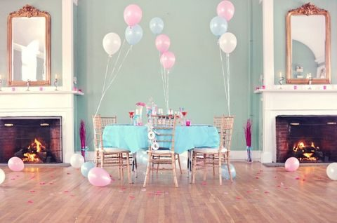 pastel bridal shower table with balloon decor