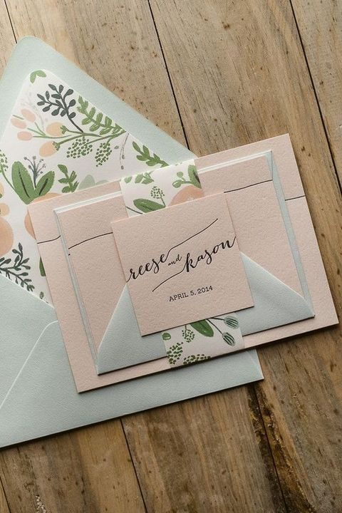pastel green and blush stationery with botanical prints
