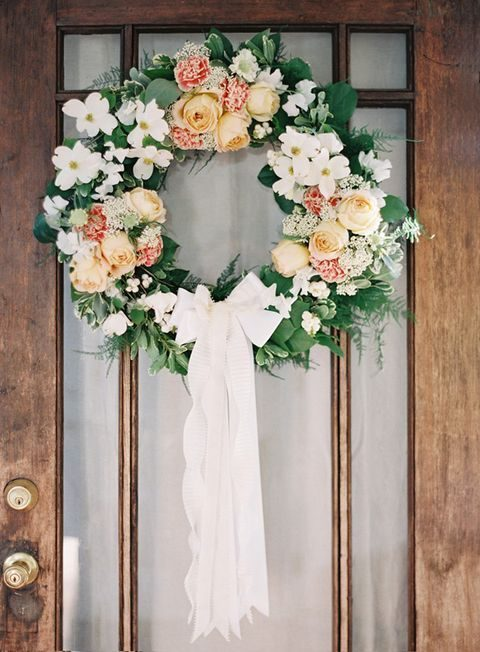 peach-colored and white spring wedding wreath