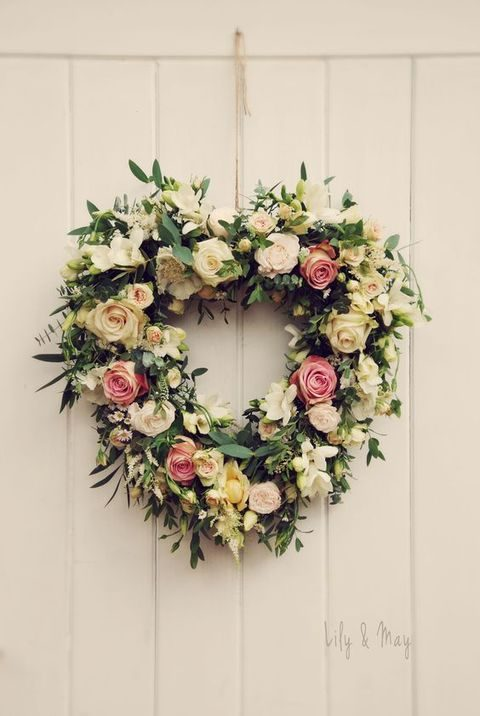 rustic lush floral wreath in a heart shape