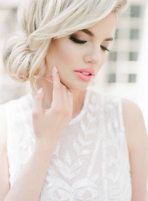 side updo and beautiful makeup with pink lips and smokeys