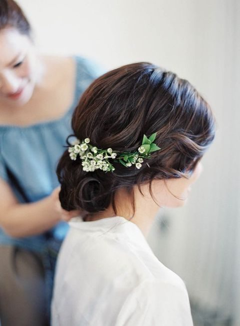 simple curly updo with flowers
