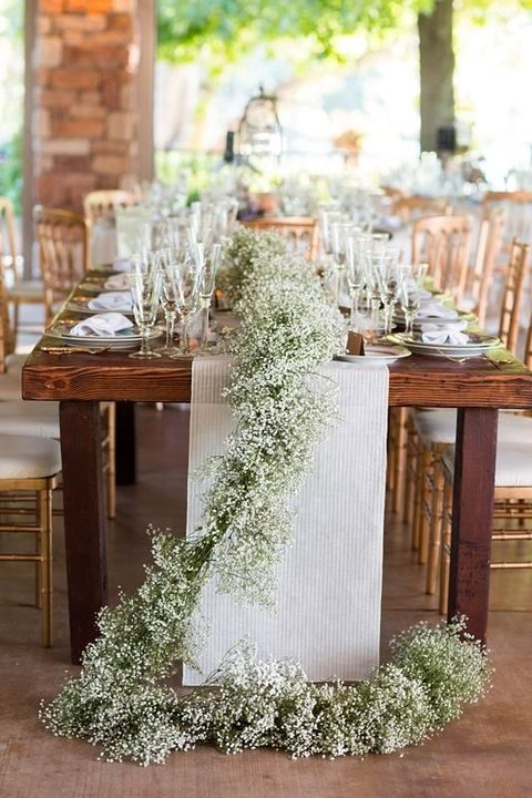striped fabric and baby's breath table runner