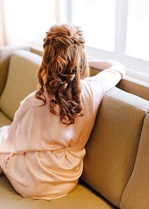 twisted curly half up half down hairstyle