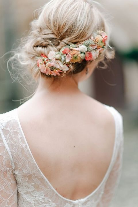 twisted updo with fresh flowers in the hair