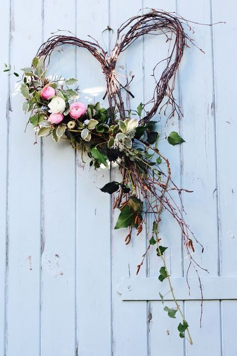 vine heart-shaped wreath with flowers and greenery