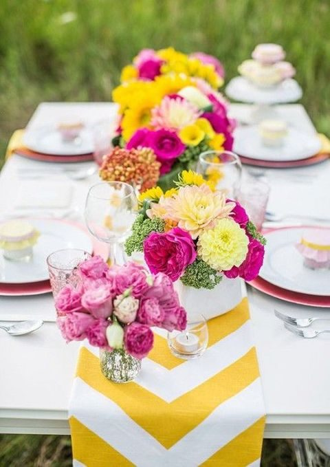 yellow and white chevron table runner with bold flowers