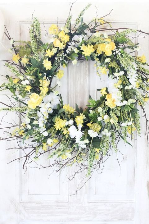 yellow and white flowers and twigs wreath