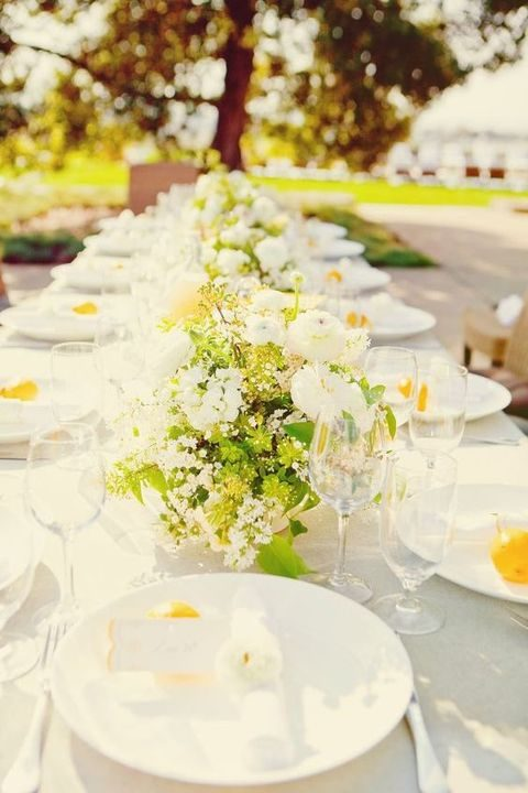 yellow and white table setting with fresh greenery
