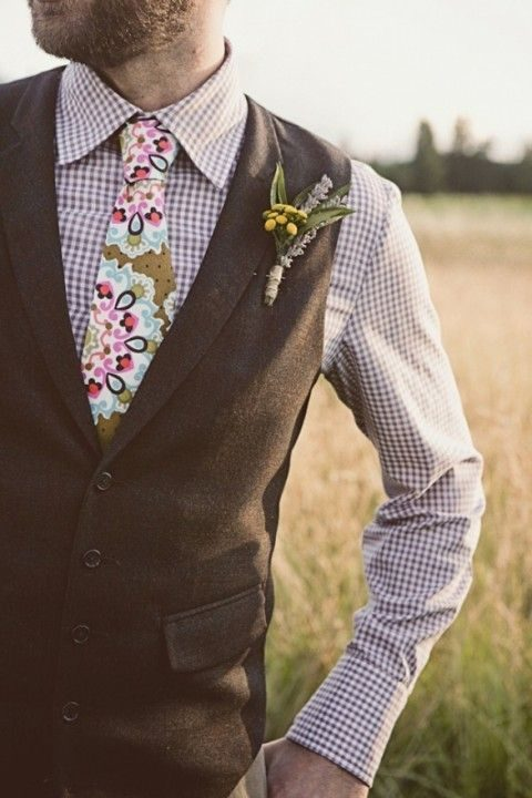 a gingham shirt, a colorful floral tie and a brown vest
