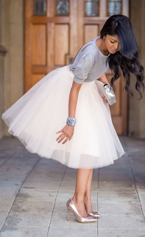 a white tutu, metallic heels and a light grey cutout back shirt