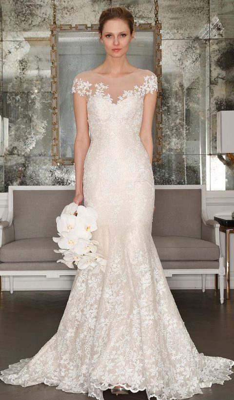 ace mermaid gown with floral details and an illusion neckline