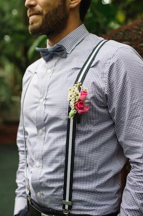 black trousers, a gingham shirt, a grey bow tie and suspenders