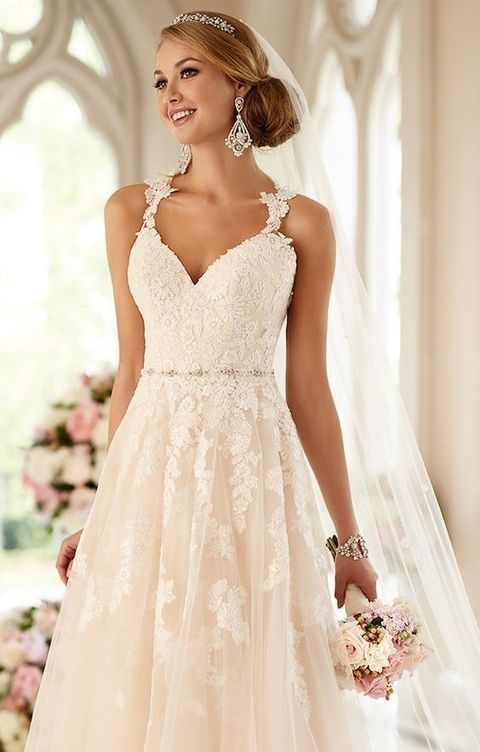 blush and wwhite wedding dress with lace appliques and straps