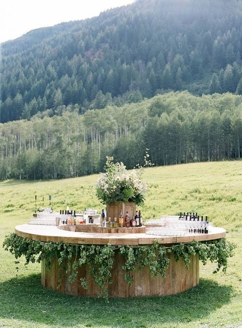 cool round bar decorated with greenery