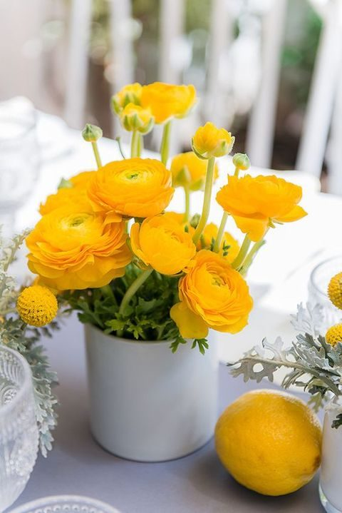 cool sunny yelloww centerpiece for a backyard wedding
