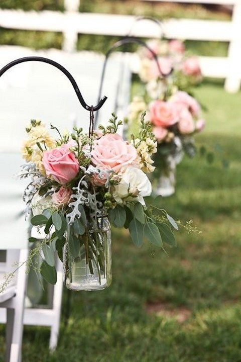 decorate your aisle with flowers on the chairs