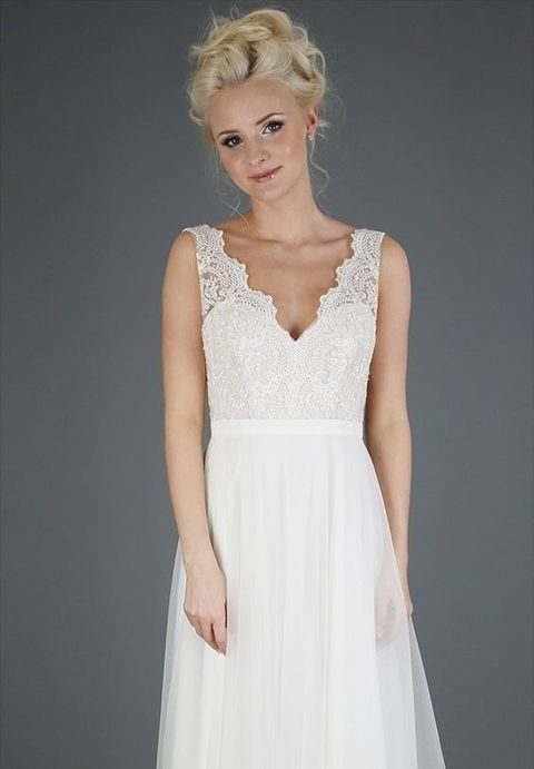 delicate embroidered lace bodice with V-neckline and illusion straps