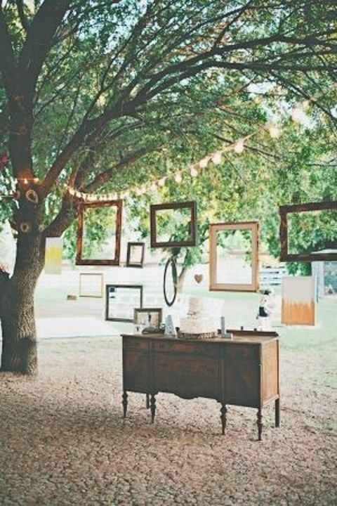dessert table with picture frames hanging all around
