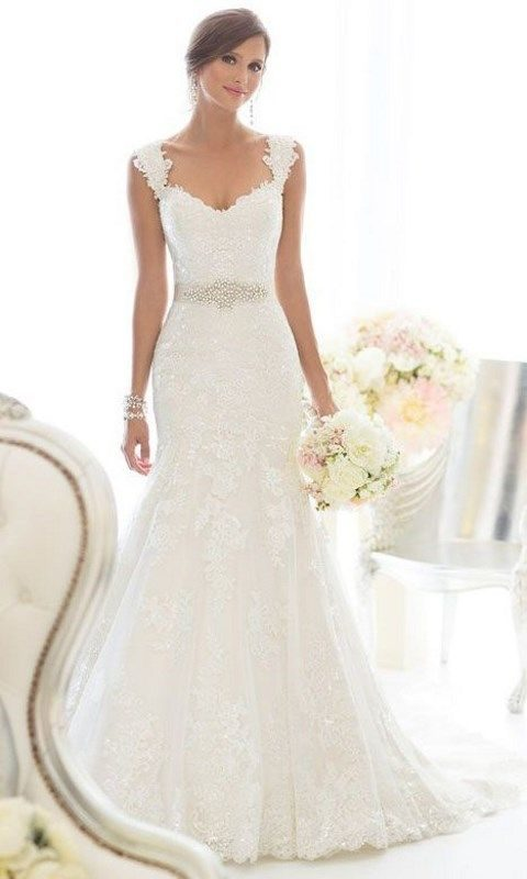 elegant lace wedding dress with wide straps and an embellished sash