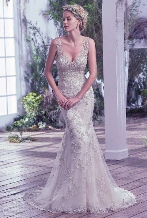 embellished sheath wedding dress features Swarovski crystals and illusion straps
