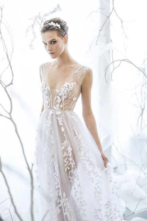 ethereal wedding dress with a V-neckline and botanical appliques by Mira Zwillinger