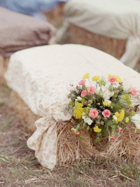 hay covered with fabric and bold flowers