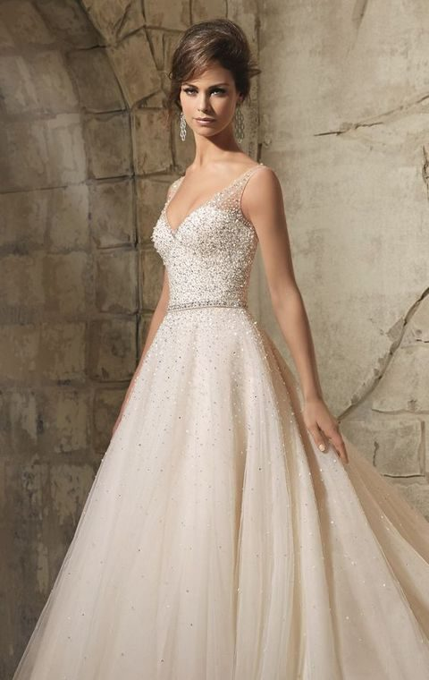 heavily embellished wedding dress with a deep V-neck and an embellished sash