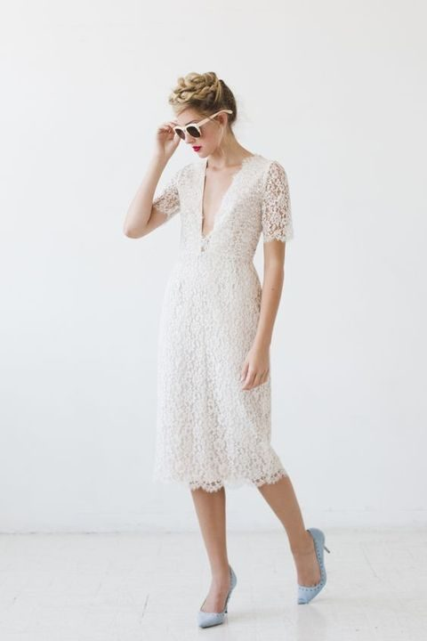 ivory lace dress with a plunging neckline and blue shoes