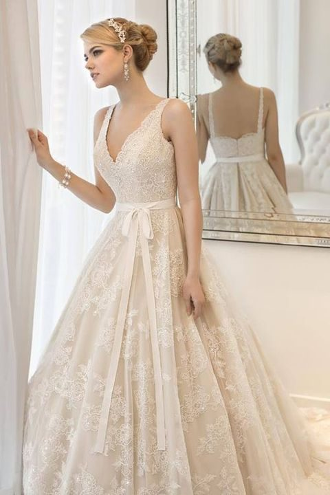 ivory lace embellished wedding dress with a deep V-neck and a sash