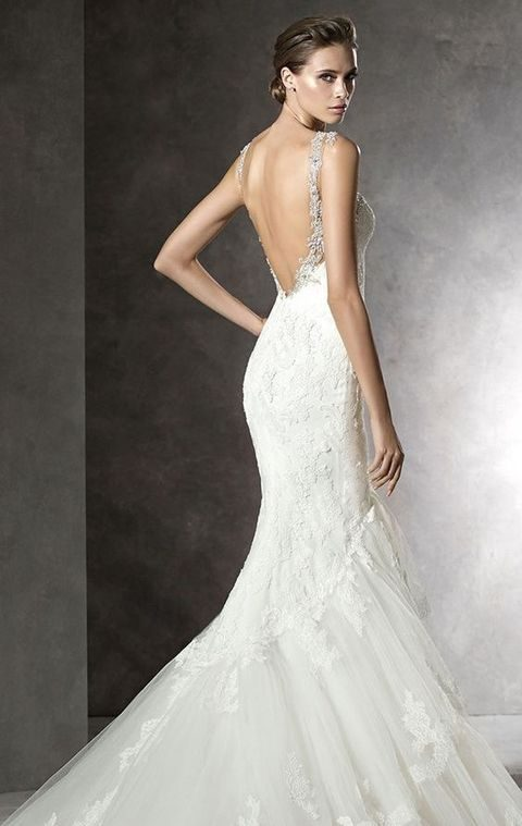lace embellished wedding dress with a cutout back
