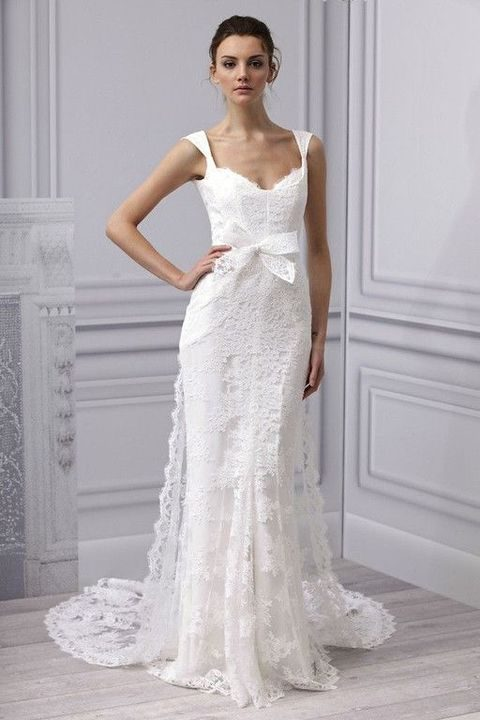 lace wedding dress with a small train and a bow sash